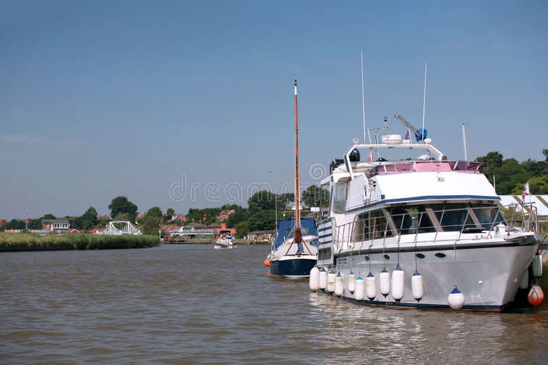 Reedham, Norfolk. A view of the village of Reedham on the Norfolk Broads, England, approaching on the River Yare from the Great Yarmouth side royalty free stock photos