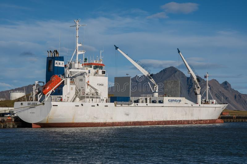 Reefer cargo ship in port of Hornafjordur. Hornafjordur Iceland - September 26. 2018: Reefer cargo ship in port of Hornafjordur stock photo