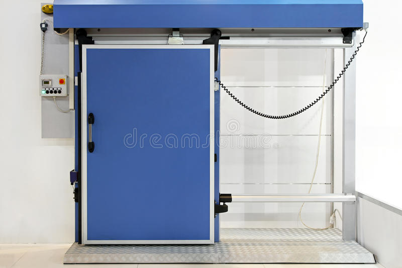 Reefer door. Automated insulated blue door at reefer refrigerator royalty free stock photos
