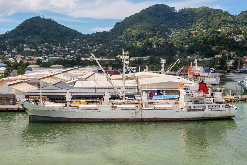 Reefer ship Platte Reefer at the harbor of Port Victoria, Mahe i. Victoria, Mahe island, Seychelles - December 17, 2015: Reefer ship Platte Reefer in import stock photography