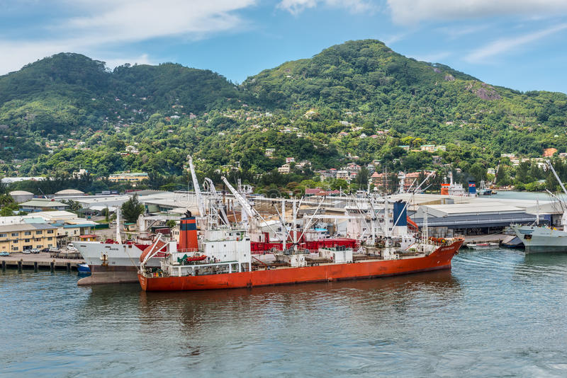 Reefer ship Retriever in the harbor of Port Victoria, Mahe island, Seychelles. Victoria, Mahe island, Seychelles - December 17, 2015: Reefer ship Retriever in stock images