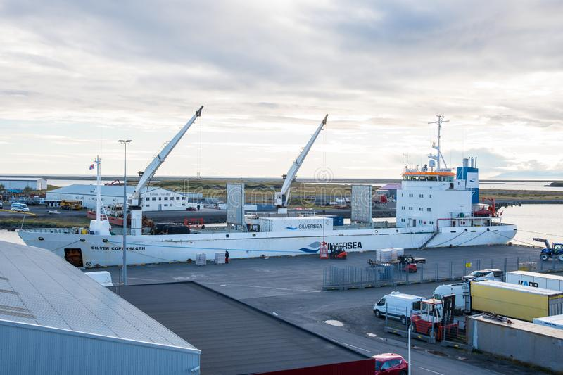 Reefer Silver Copenhagen loading in port of Hornafjordur. Hornafjordur Iceland - September 14. 2018: Reefer Silver Copenhagen loading in port of Hornafjordur royalty free stock images
