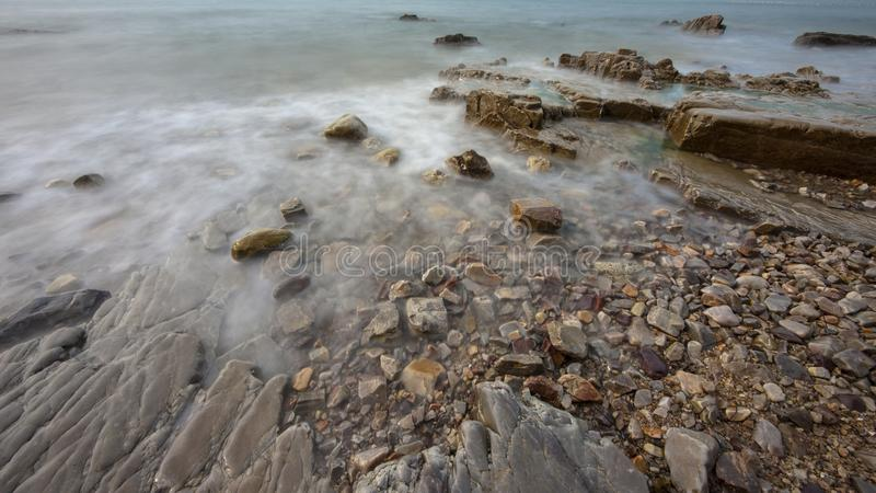 Reefs and waves. Jiaodong Peninsula is located in the northeast coastal area of China`s North China Plain, east of Shandong Province, hilly land, north of Bohai stock images