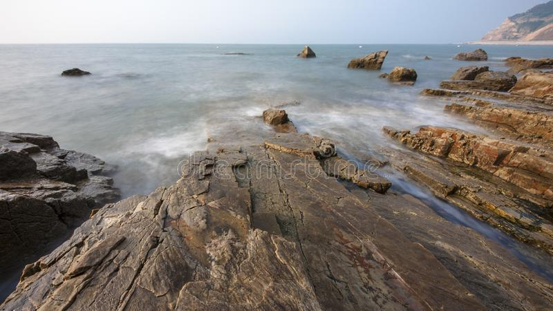 Reefs and waves. Jiaodong Peninsula is located in the northeast coastal area of China`s North China Plain, east of Shandong Province, hilly land, north of Bohai stock photos