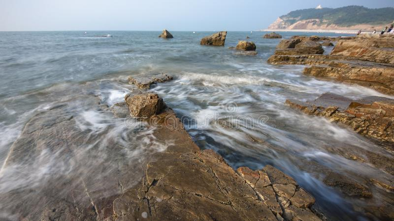Reefs and waves. Jiaodong Peninsula is located in the northeast coastal area of China`s North China Plain, east of Shandong Province, hilly land, north of Bohai royalty free stock photography