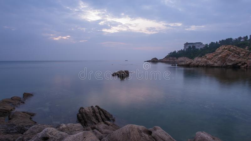 Reefs and waves. Jiaodong Peninsula is located in the northeast coastal area of China`s North China Plain, east of Shandong Province, hilly land, north of Bohai stock photo