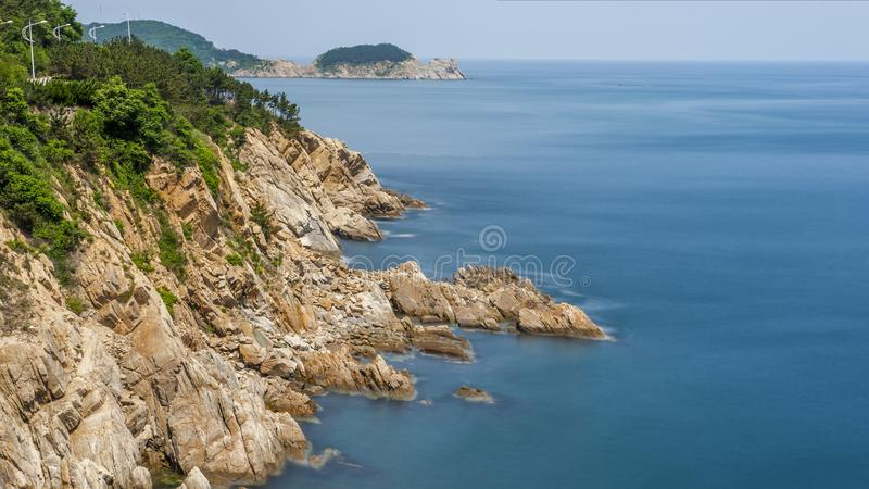 Reefs and waves. Jiaodong Peninsula is located in the northeast coastal area of China`s North China Plain, east of Shandong Province, hilly land, north of Bohai royalty free stock photos