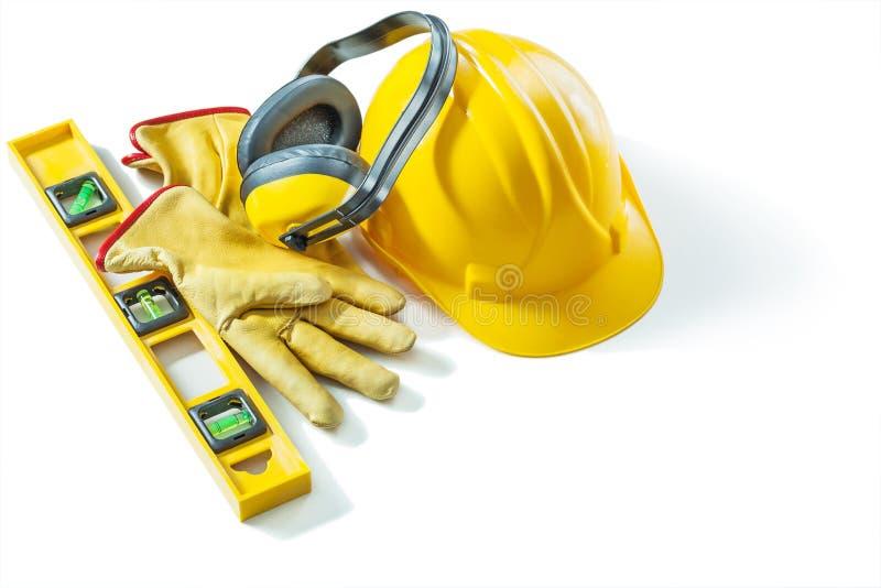 Reeks bouwhulpmiddelen helm handschoenen aarfoonniveau geïsoleerd op witte achtergrond stock afbeelding