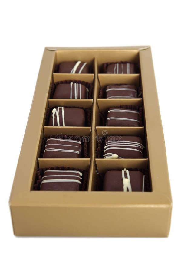 Reeks chocolade in een doos op witte achtergrond stock foto's
