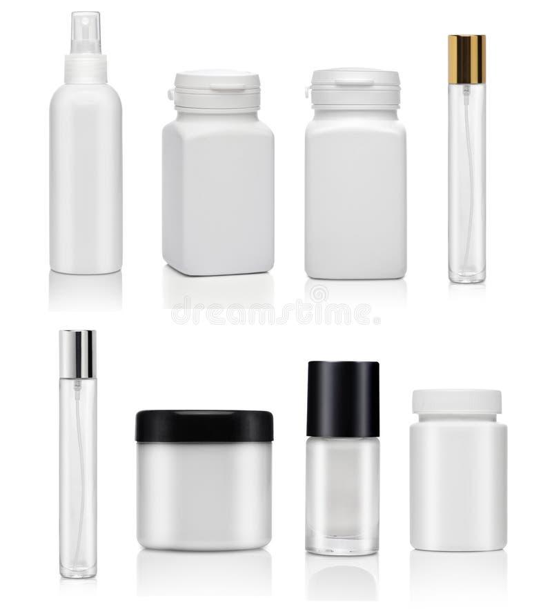 Reeks cosmetischee producten op een witte achtergrond stock foto