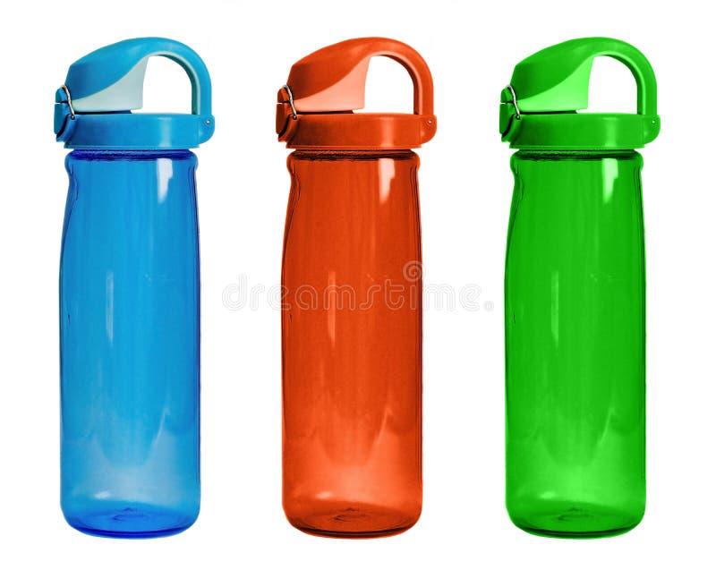 Reeks geïsoleerde kleurenflessen voor sport Drie plastic flessen F royalty-vrije stock afbeelding