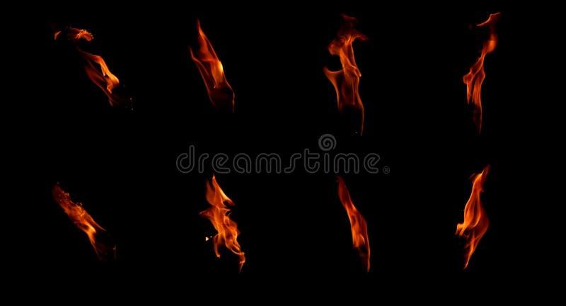 Reeks geïsoleerde vlammen op een zwarte achtergrond stock fotografie