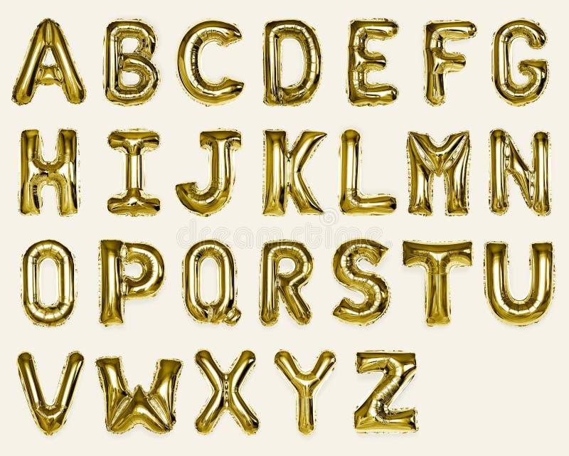 Reeks gouden hoofda-z alfabetballons stock fotografie