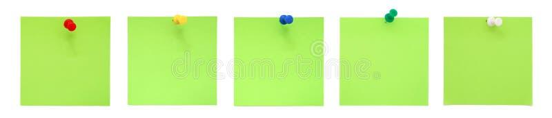 Reeks groene kleverige nota's met punaisen royalty-vrije stock afbeelding