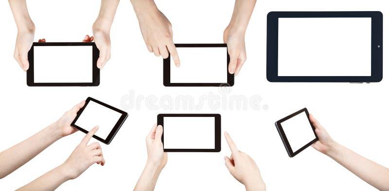 Reeks handen met tabletpc op wit wordt geïsoleerd dat stock afbeelding