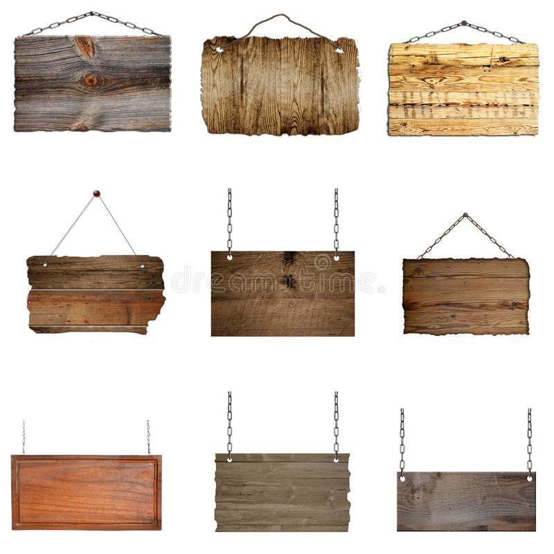 Reeks hangende houten borden op metaalkettingen royalty-vrije stock foto