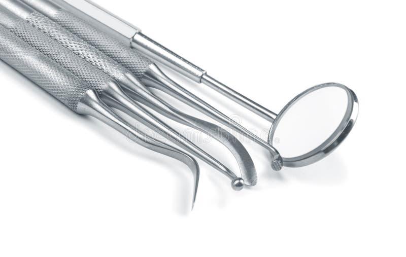 Reeks hulpmiddelen van de metaalmedische apparatuur voor tanden tandzorg stock foto's