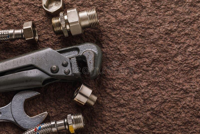 Reeks hulpmiddelen voor loodgieterswerk met exemplaarruimte royalty-vrije stock afbeelding