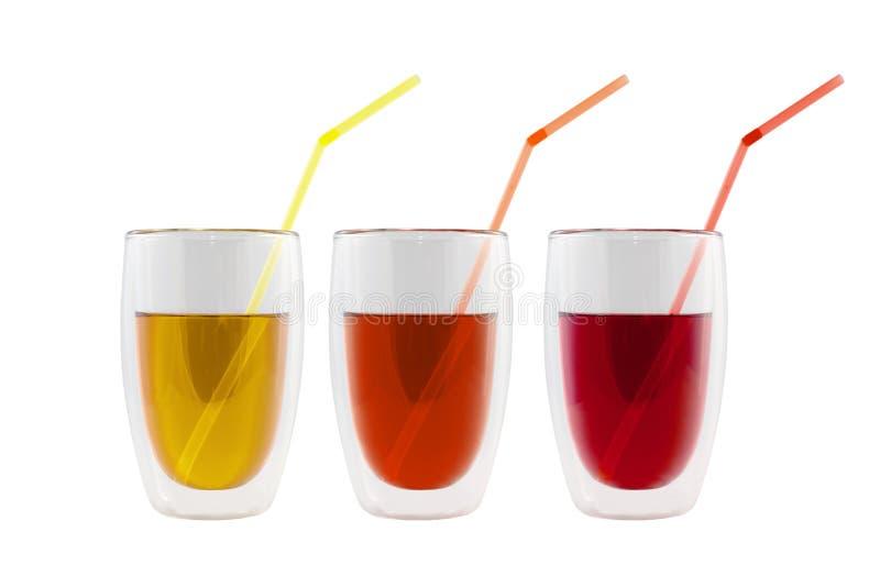 Reeks kleurige dranken met rietjes royalty-vrije stock foto