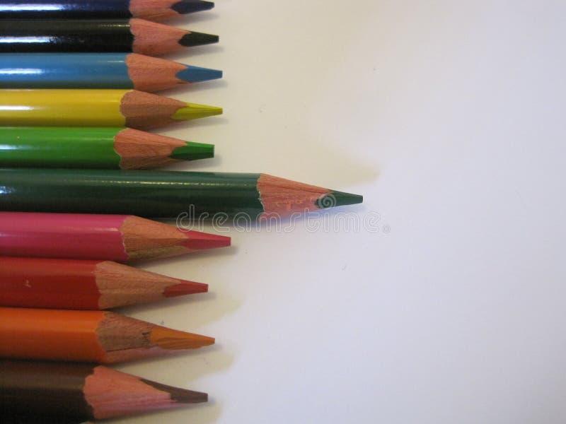 Reeks kleurpotloden op wit stock afbeelding
