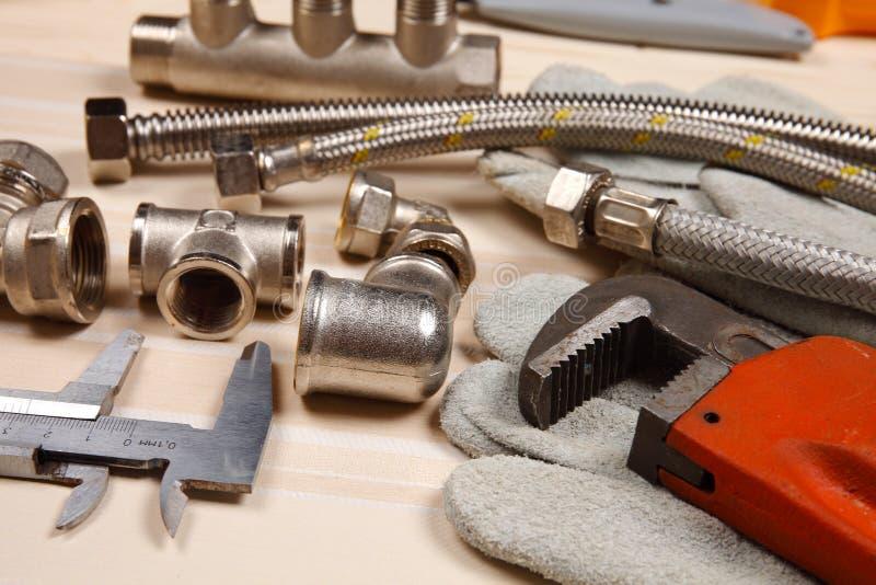 Reeks loodgieterswerk en hulpmiddelen stock afbeeldingen