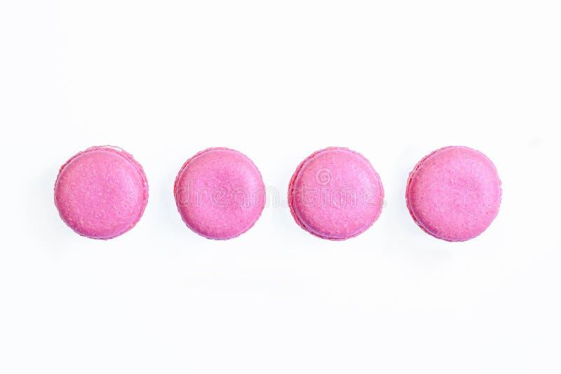Reeks roze franse macarons, geïsoleerd op witte achtergrond royalty-vrije stock fotografie