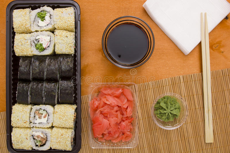 Reeks sushi en broodjes stock foto's