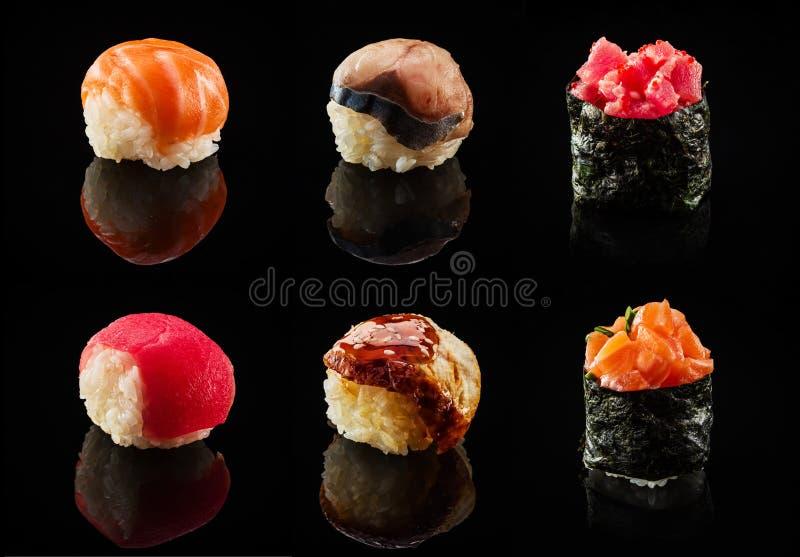 Reeks sushiballen en makibroodjes stock afbeeldingen