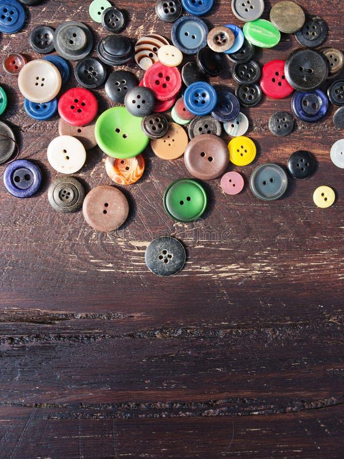 Reeks uitstekende knopen op oud hout royalty-vrije stock foto's