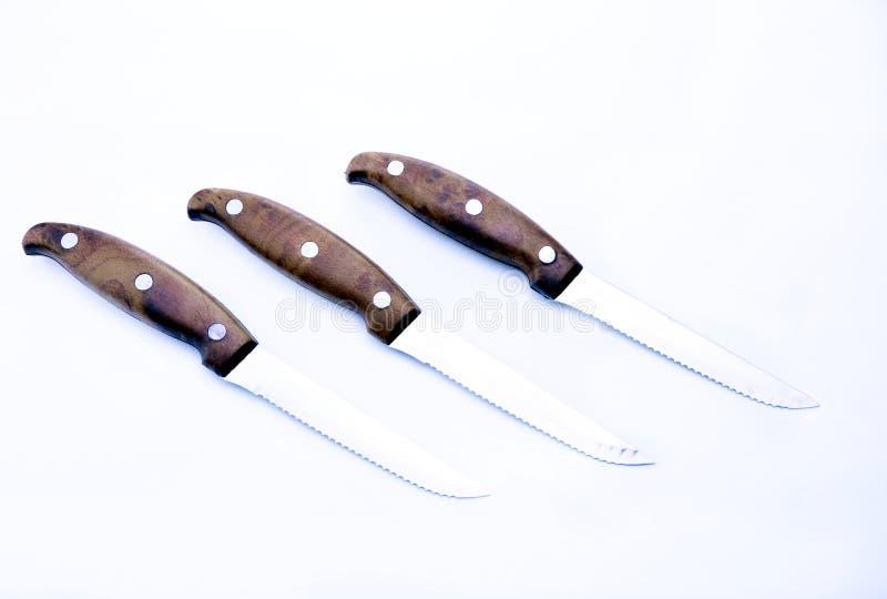 Reeks van drie messen op een witte achtergrond stock afbeeldingen
