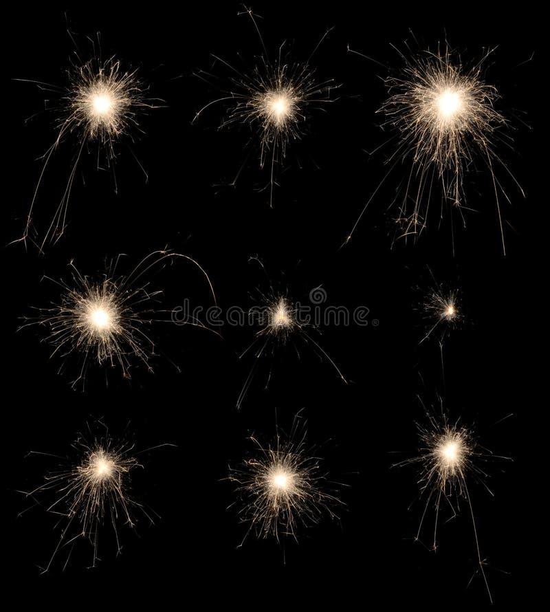 Reeks van het branden van sterretjes op zwarte achtergrond. royalty-vrije stock foto