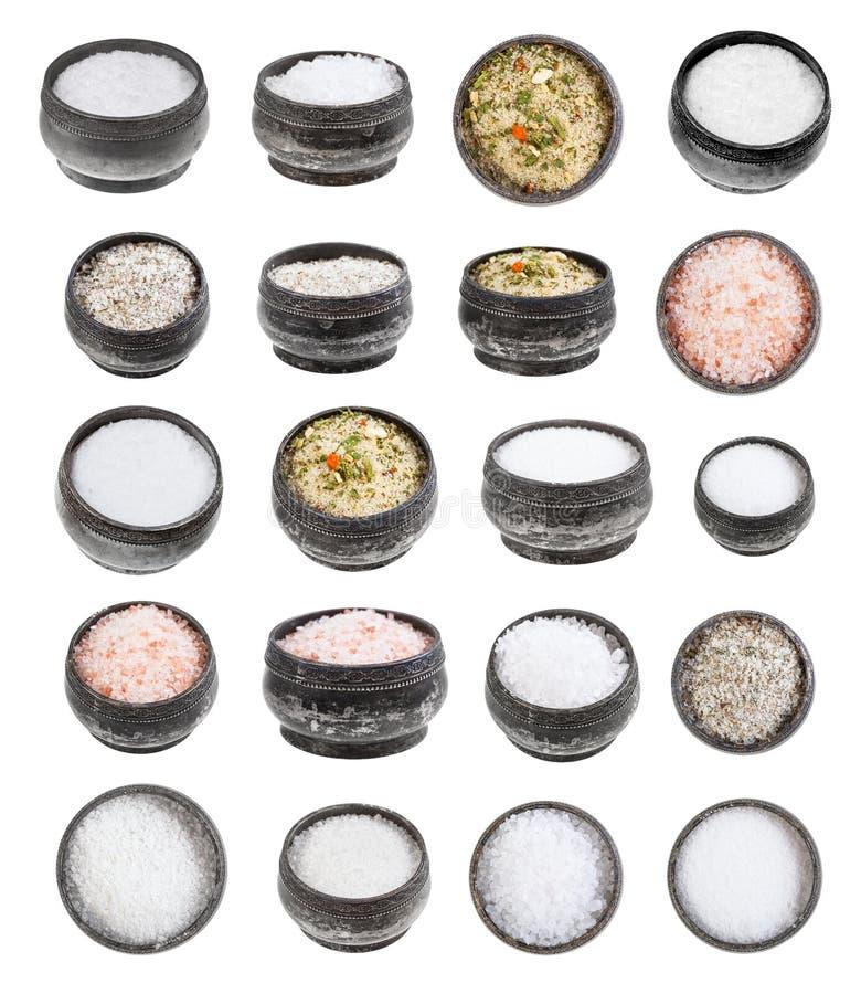 Reeks van zilveren zoute kelder met diverse zouten stock fotografie