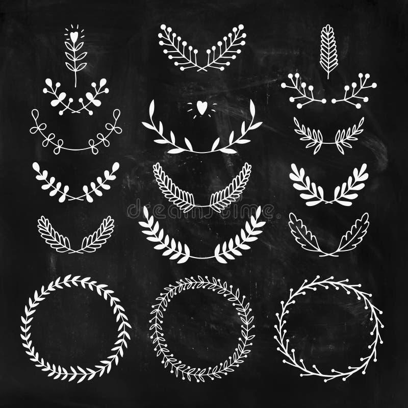 Reeks vector handdrawn laurels en kronen vector illustratie