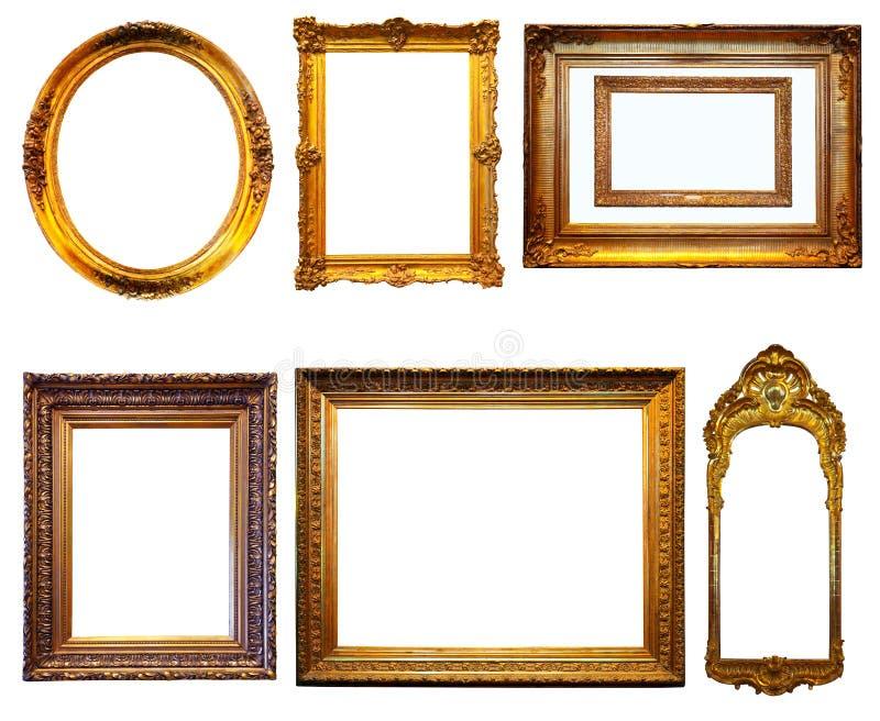 Reeks vergulde frames. Geïsoleerdd over witte achtergrond stock afbeelding
