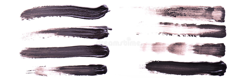 Reeks zwarte verf of mascaraslagen die op witte achtergrond worden geïsoleerd stock foto