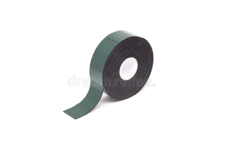 Reel of double-sided tape on a white background, isolate, green double-sided tape, close-up, material stock photography