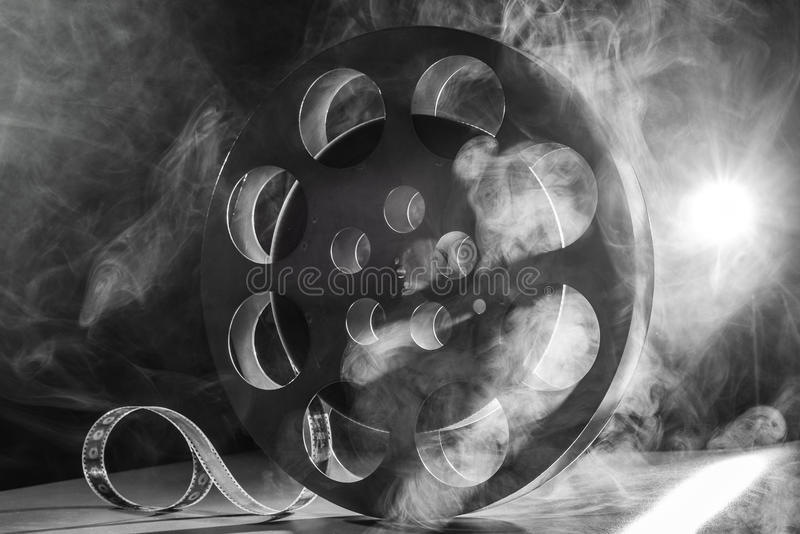 Reel of film retro in the smoke. black and white stock photos