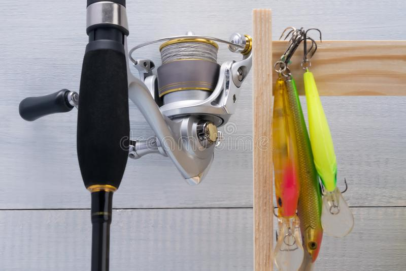 Reel on a fishing rod and bait for fishing, close-up. Reel on a fishing rod and  bait for fishing, close-up stock photo