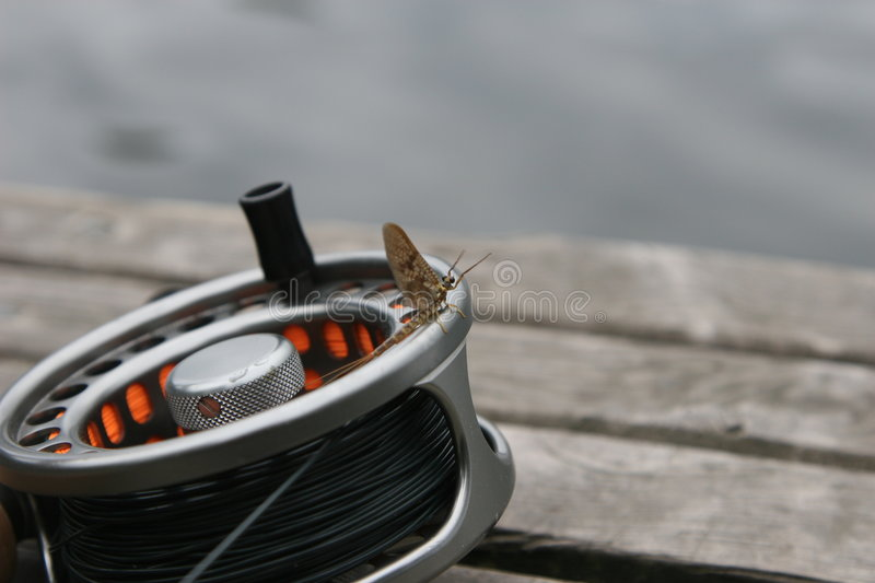 The Reel With May Fly Royalty Free Stock Images