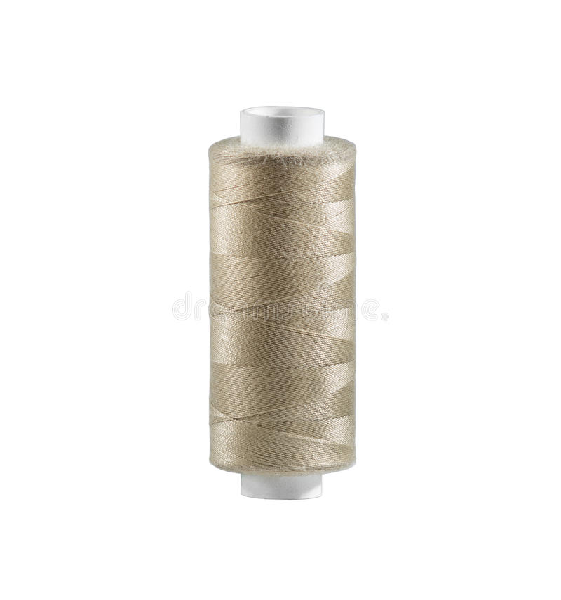 Reel of thread, on wite background. One light-brown reel of thread, on wite background, isolated royalty free stock photo