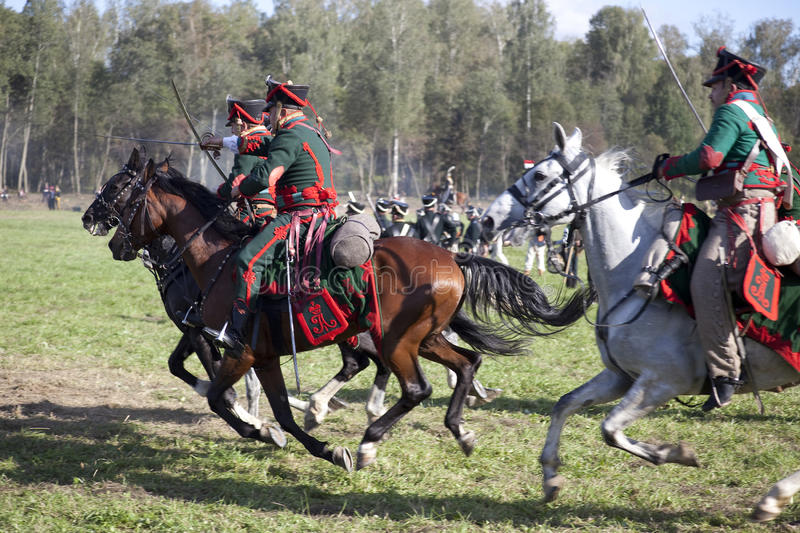 Reenactment of the Borodino battle between Russian and French armies in 1812. Russian cavalry at Borodino. In the foreground the Russian cavalry attacks royalty free stock images