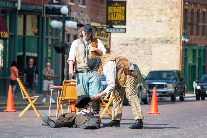 Reenactment of Historic Gunfight. DEADWOOD, SD - AUGUST 26: Actors reenact a gunfight in Deadwood, SD on August 26, 2015 royalty free stock photos