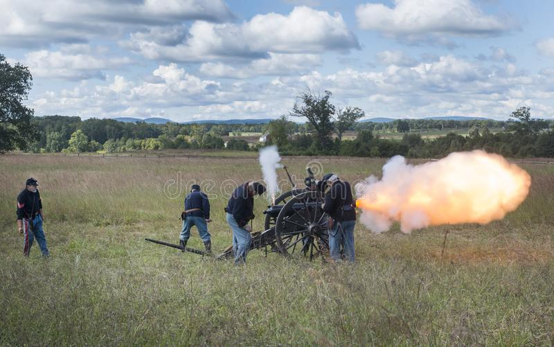Reenactment Union soldiers firing cannon. US civil war reenactment with Union soldiers firing cannon at Gettysburg, Pennsylvania royalty free stock image