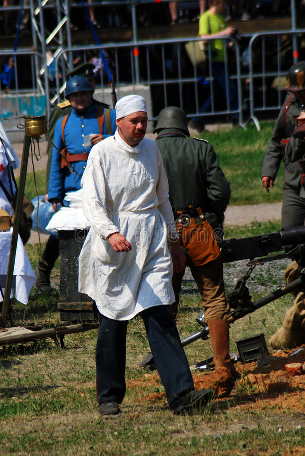 Reenactor dressed as a doctor walks on the battle field. stock images