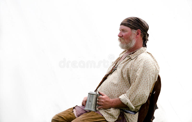 Reenactor listening to stories with a mug stock images