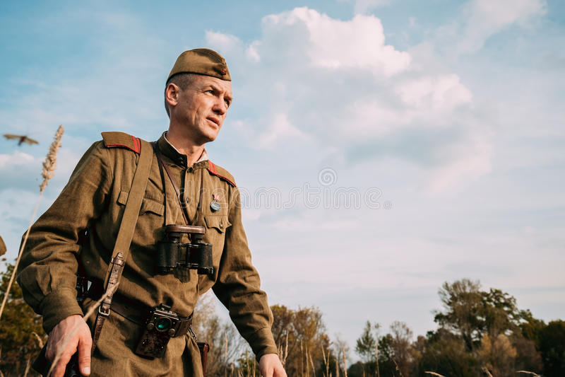 Reenactor Man Dressed As Russian Soviet Red Army Infantry Soldier. Dyatlovichi, Belarus - October 1, 2016: Reenactor Man Dressed As Russian Soviet Red Army stock photography