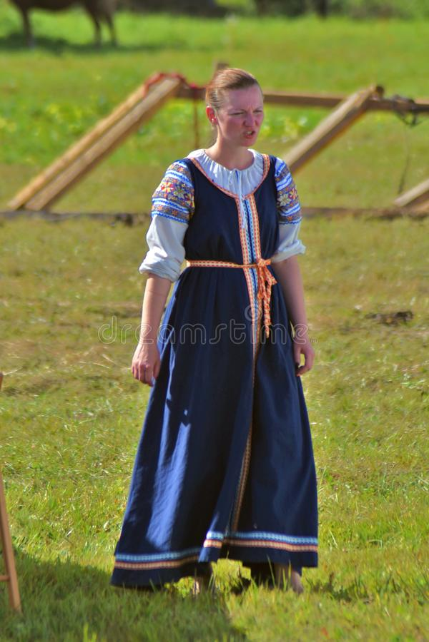 Reenactor woman at Borodino battle historical reenactment in Russia. BORODINO, MOSCOW REGION, RUSSIA - SEPTEMBER 01, 2019: Reenactor woman at Borodino battle stock photo