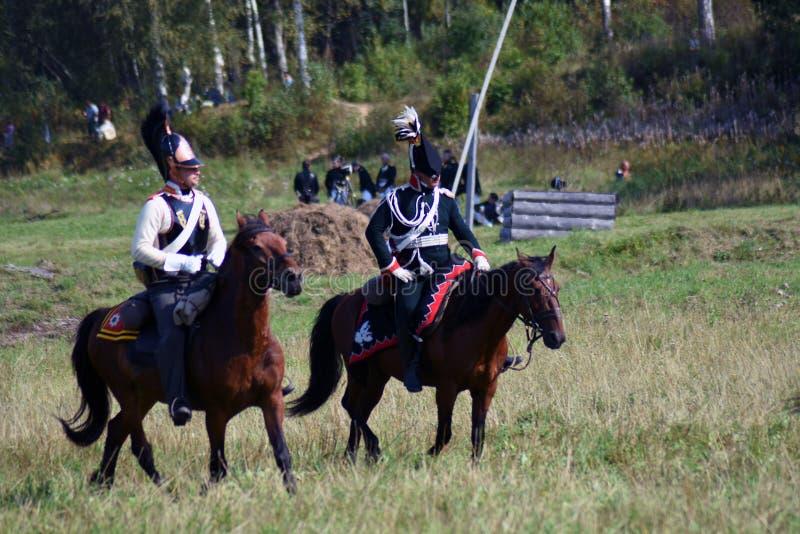 Reenactors horse riders at Borodino battle historical reenactment in Russia. BORODINO, MOSCOW REGION - SEPTEMBER 02, 2018: Reenactors horse riders at Borodino stock photography