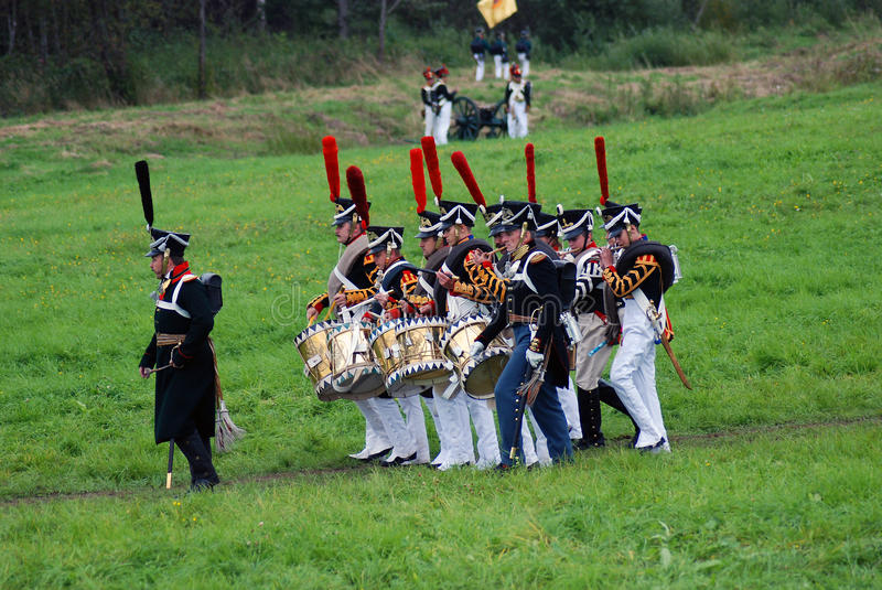 Reenactors-musicians march holding drums. BORODINO, MOSCOW REGION - SEPTEMBER 04, 2016: enactors-musicians march holding drums. Borodino battle historical royalty free stock images