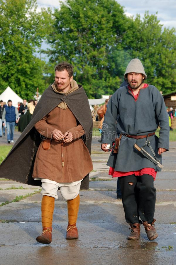 Reenactors walk on the street. They paritcipate in historical festival Times and Ages. Place: Kolomenskoye park, Moscow. Date: June 12, 2016 royalty free stock photography